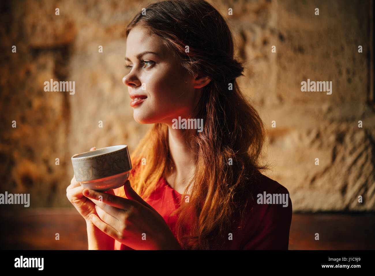 Caucasian woman holding cup of tea - Stock Image