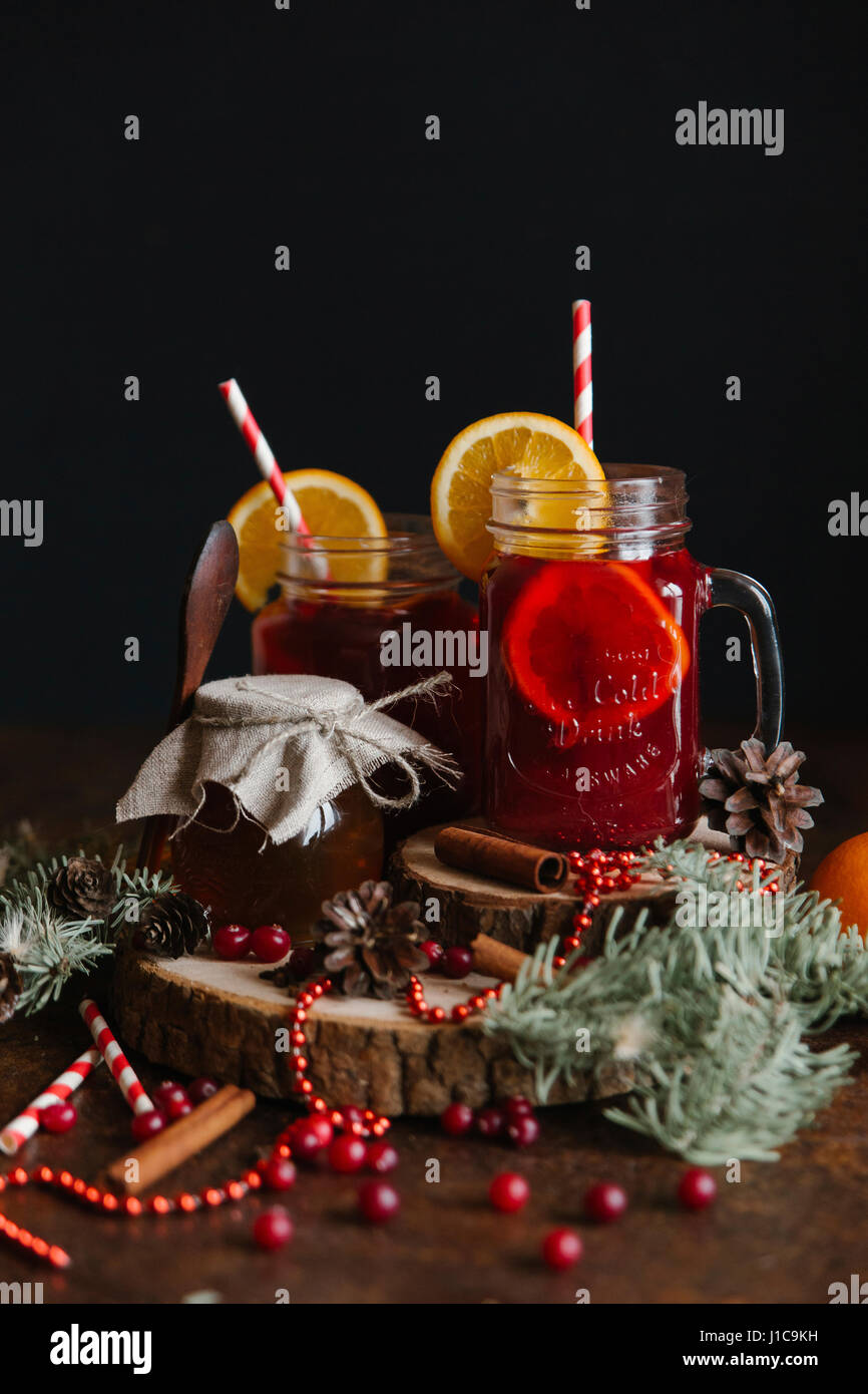 Fruit tea with cinnamon sticks - Stock Image