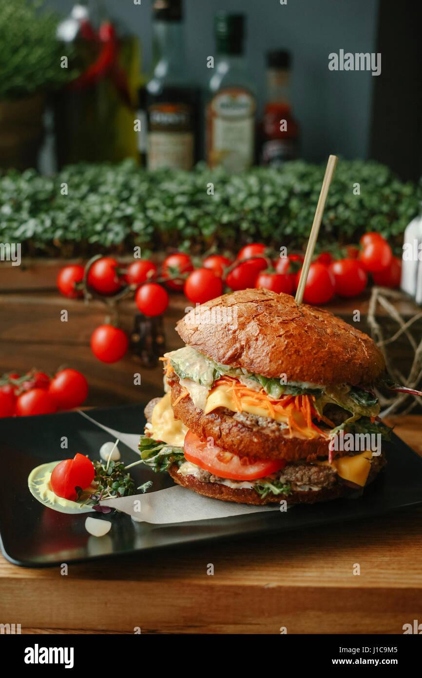Gourmet cheeseburger on plate - Stock Image