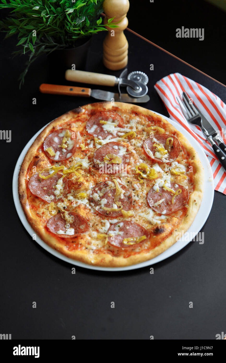 Gourmet pizza with pepperoni - Stock Image