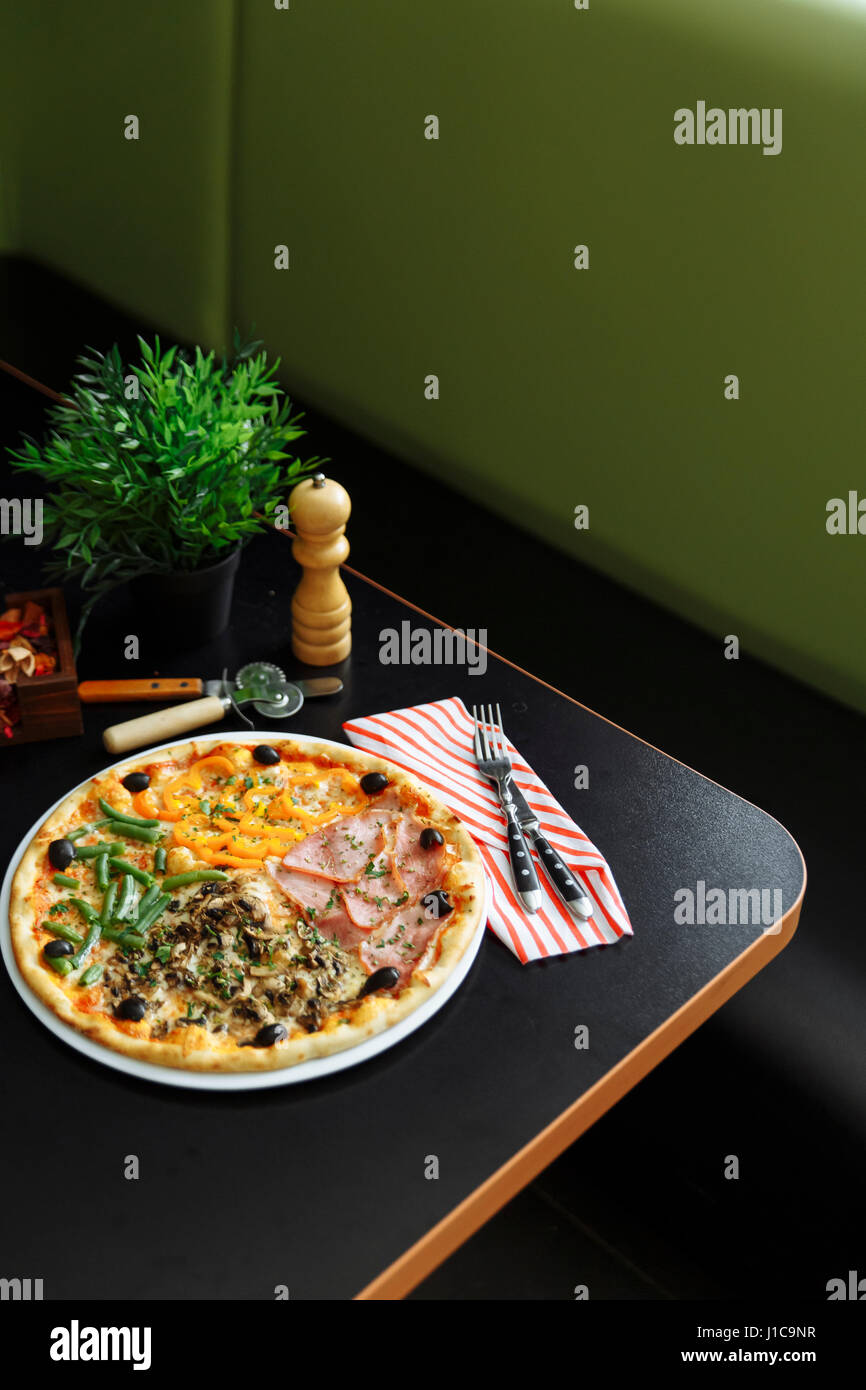 Gourmet pizza on plate - Stock Image