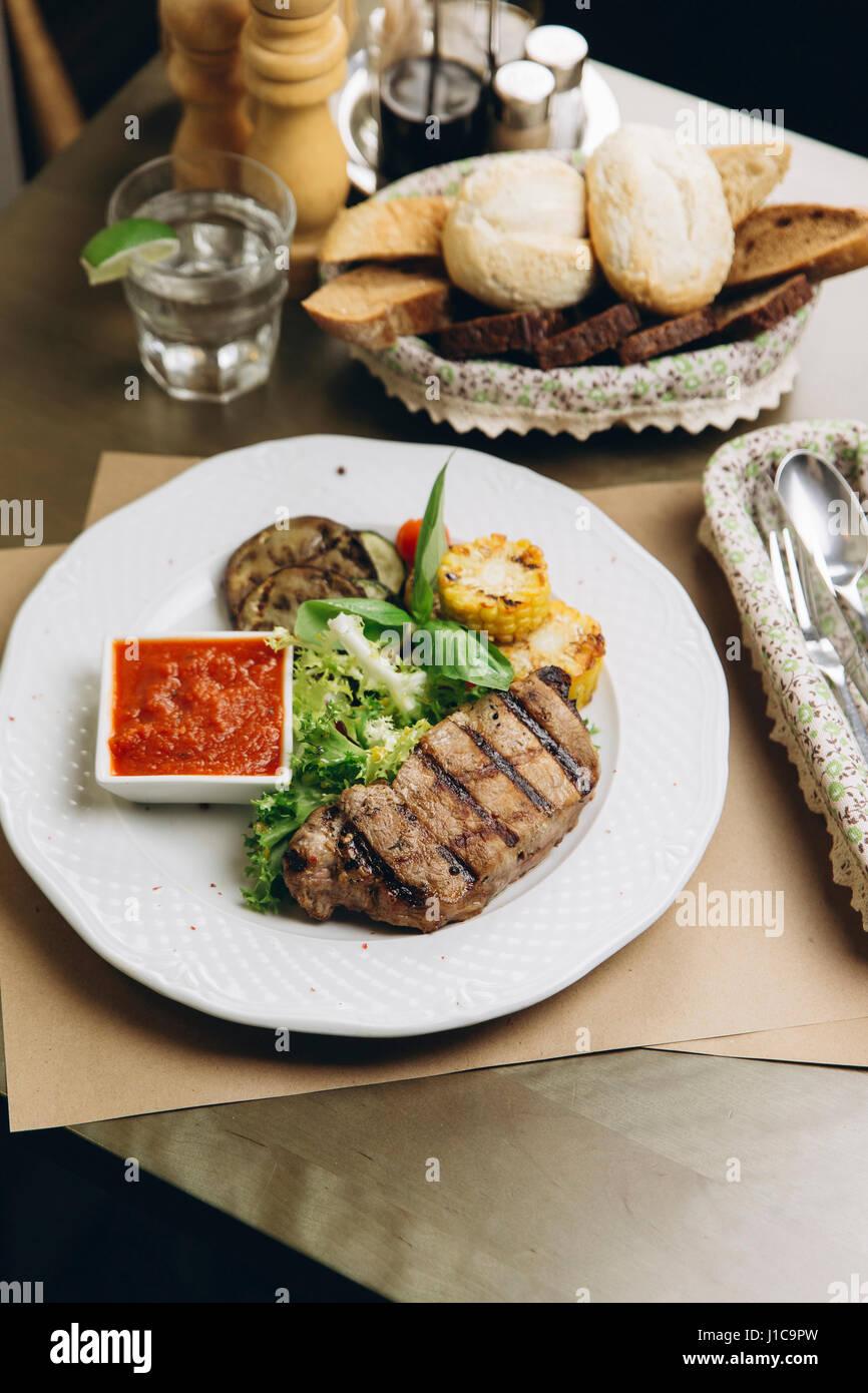 Steak dinner on plate - Stock Image