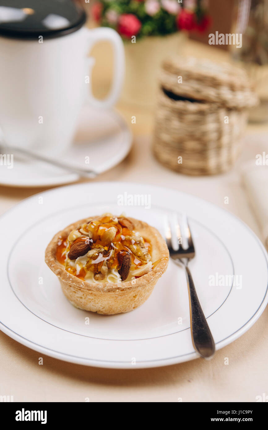 Tart on plate with fork - Stock Image