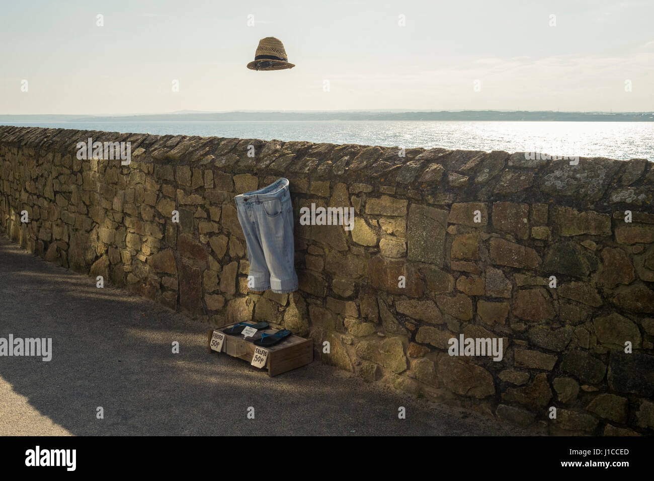 An invisible man installation at St Ives, Cornwall where tourists and locals can take a selife with the invisible - Stock Image