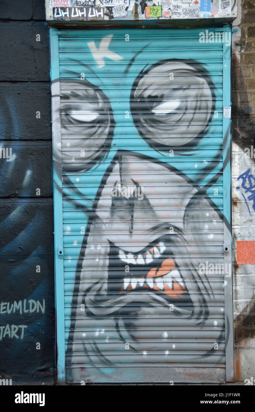 Mural painting of an agitated angry face. - Stock Image