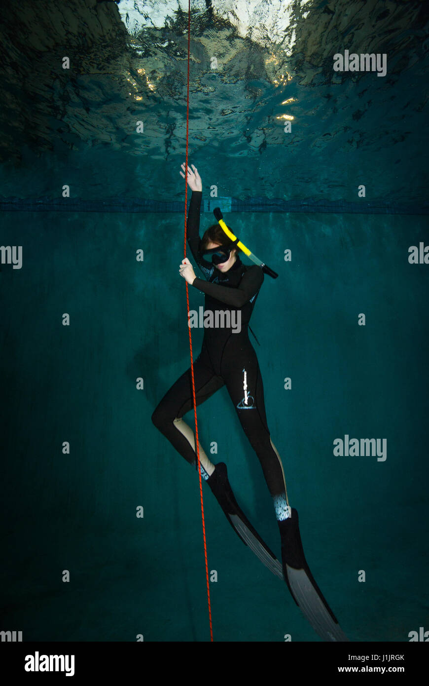 Young woman in a free diving class - Stock Image