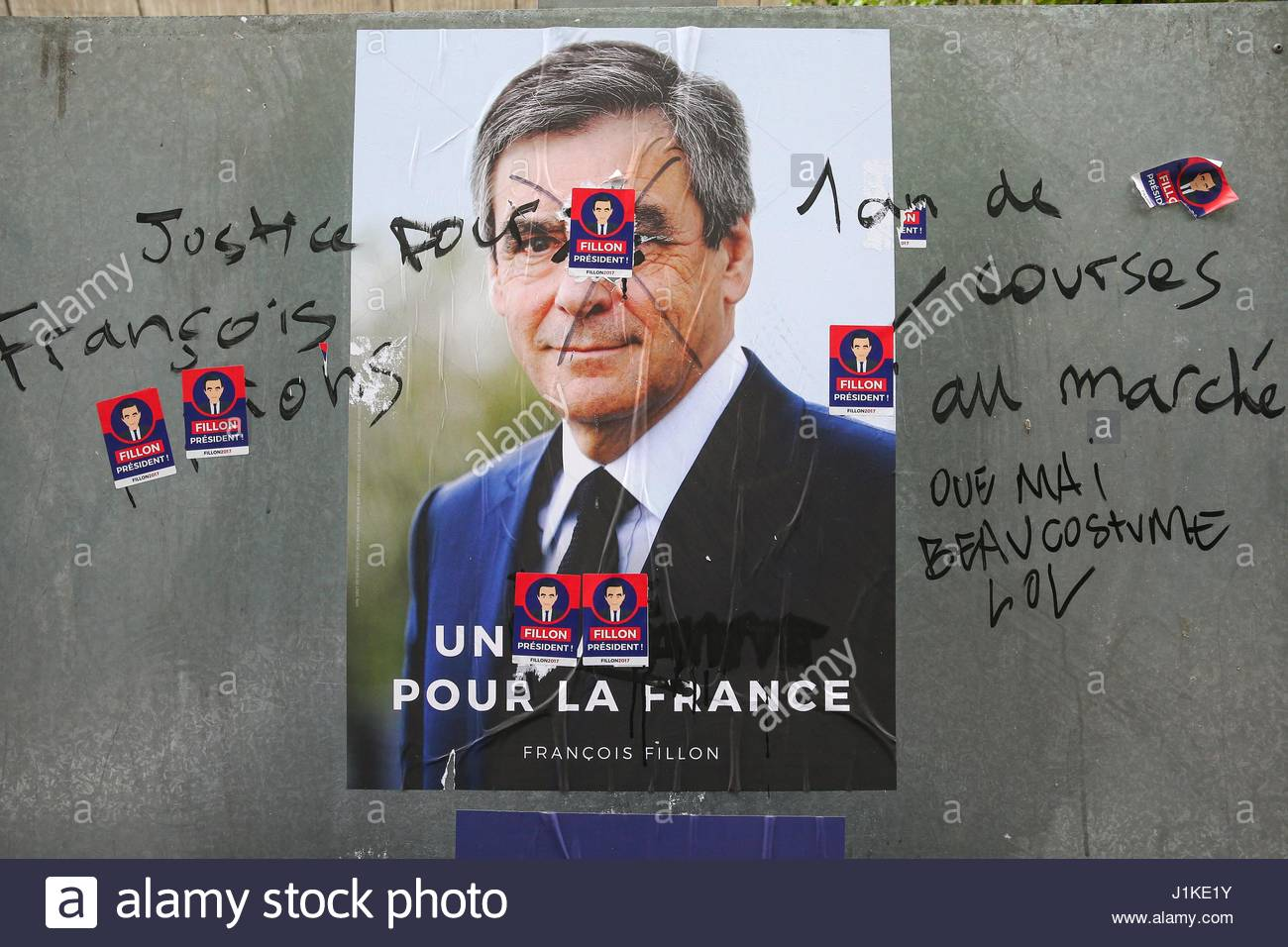 Paris, France. 22nd Apr, 2017. Campaign posters are seen written on and covered up in the streets of Paris, France - Stock Image