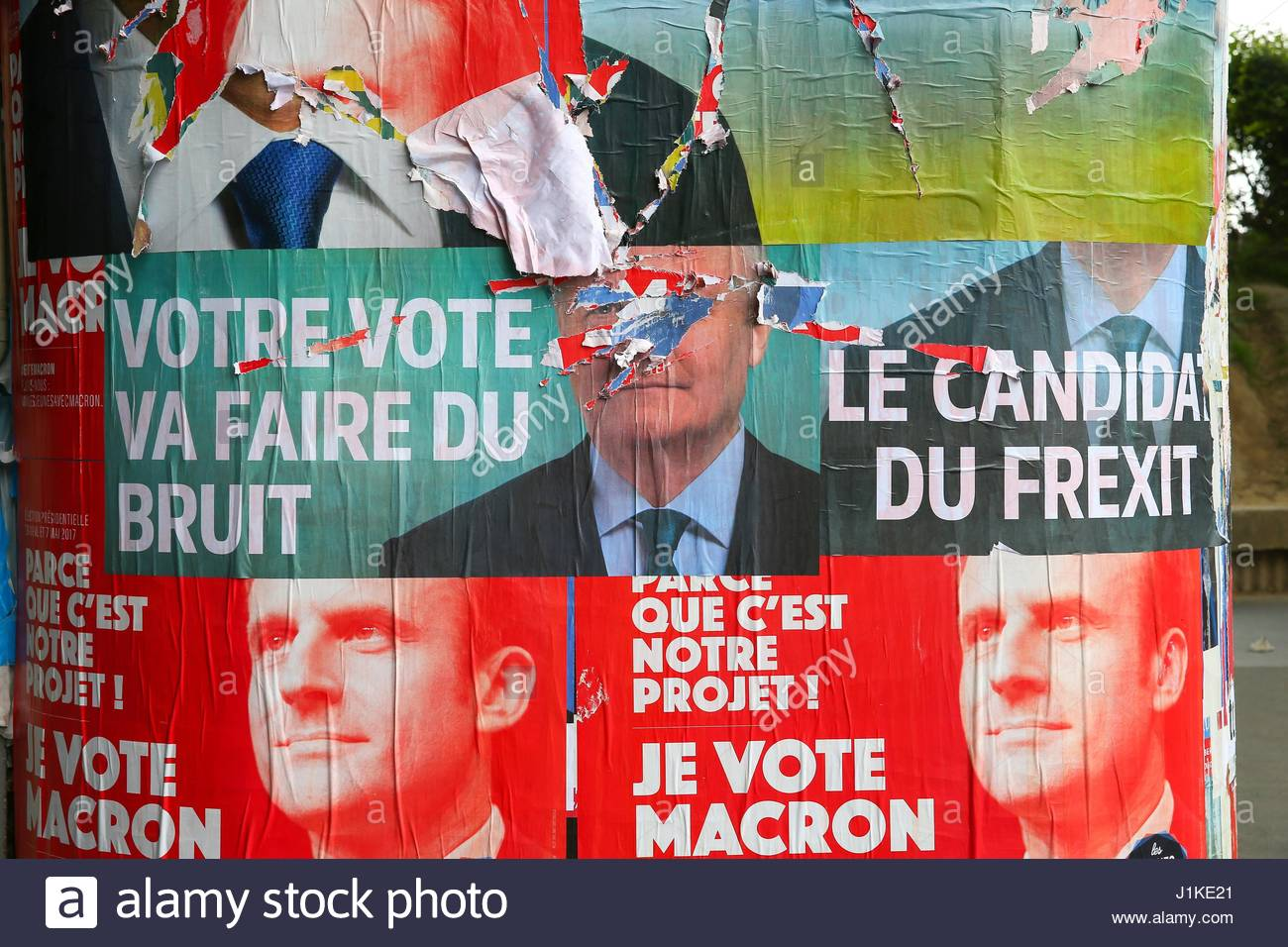 Paris, France. 22nd Apr, 2017. Campaign posters are seen torn and covered up in the streets of Paris, France on - Stock Image