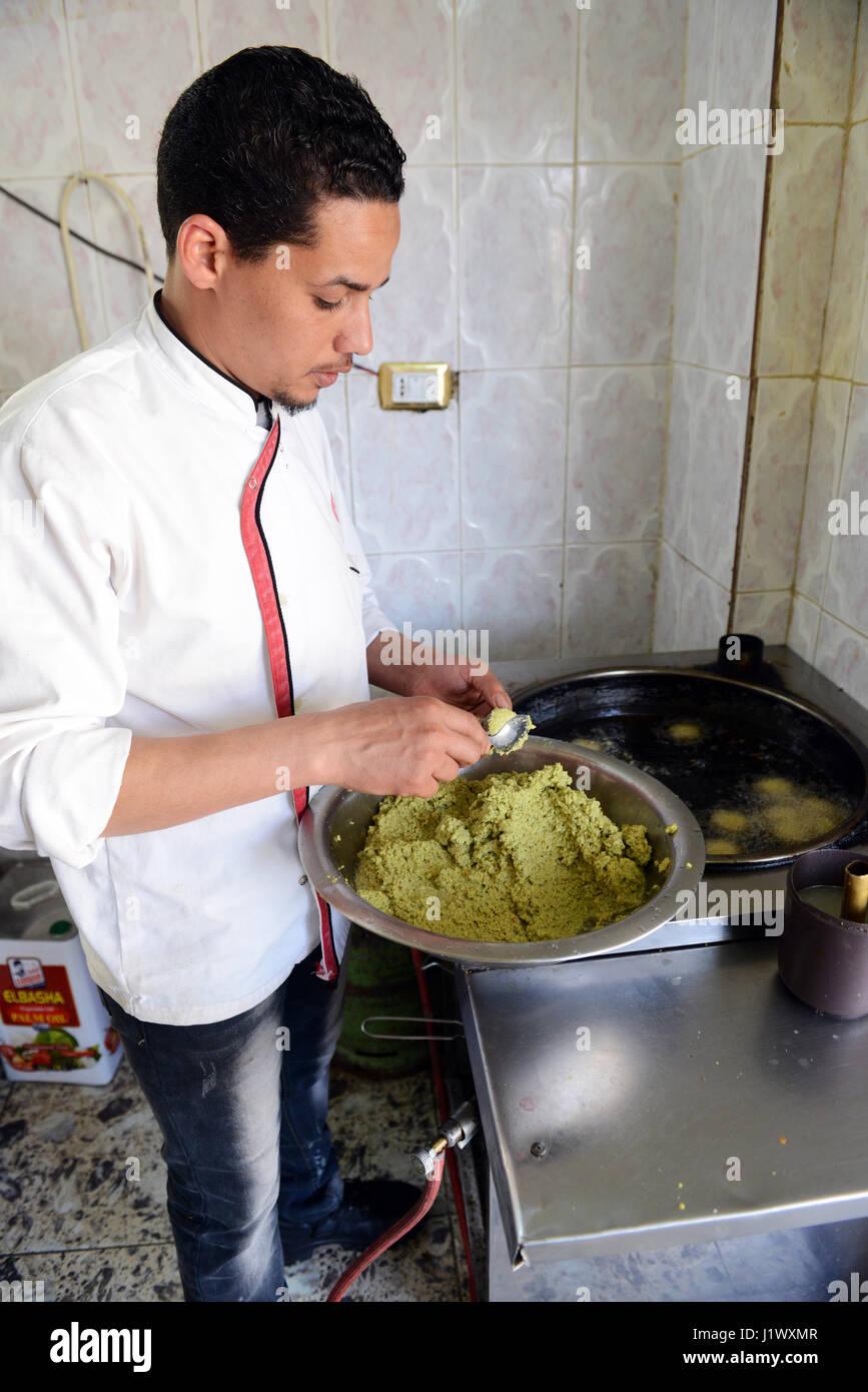 A Jordanian man preparing Falafel in his small Falafel shop in South Jordan. - Stock Image