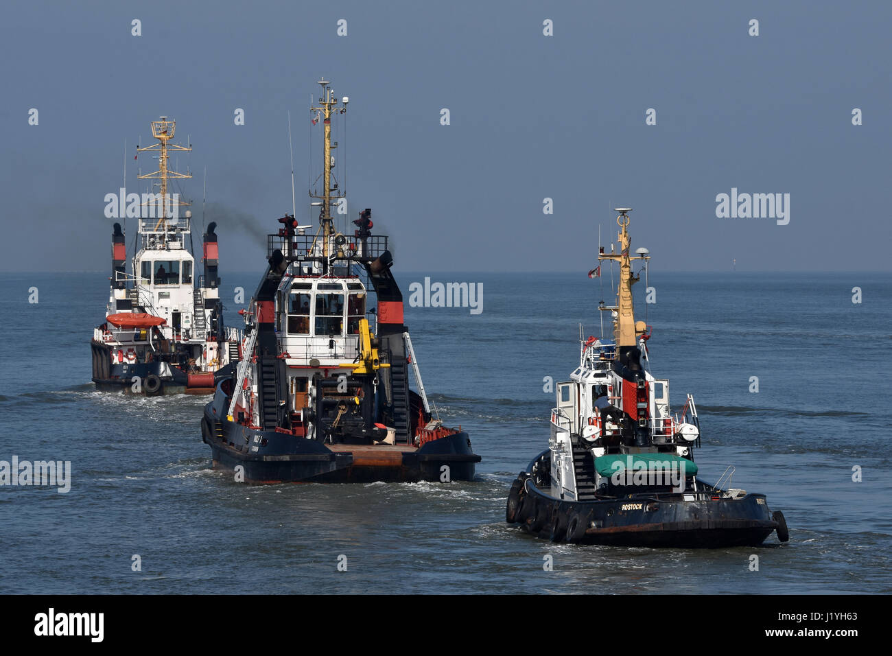 Wulf tugboats heading for sea - Stock Image