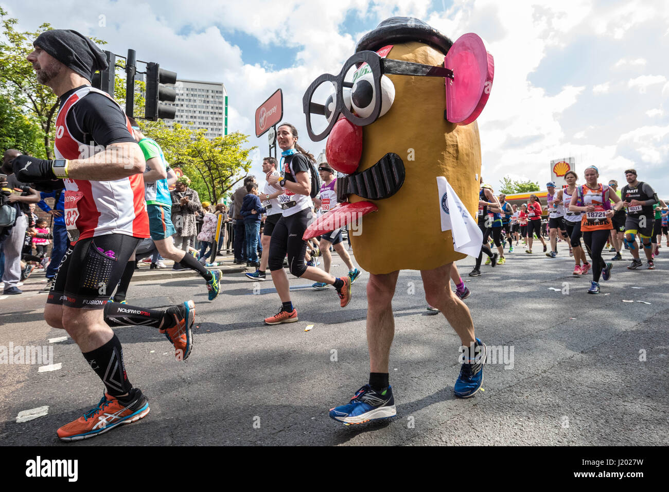 London, UK. 23rd Apr, 2017. London Marathon passes through Deptford Credit: Guy Corbishley/Alamy Live News - Stock Image