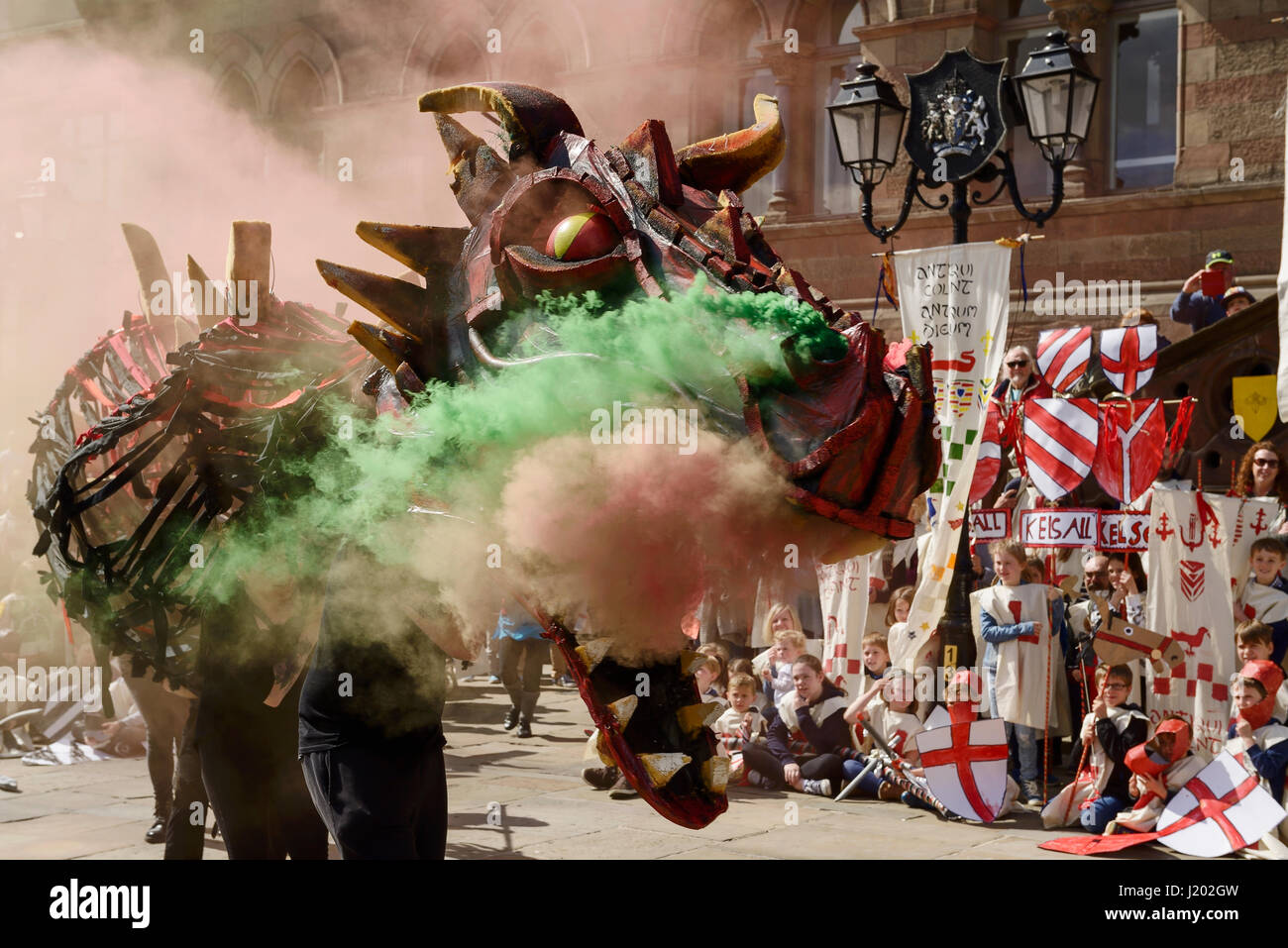 Chester, UK. 23rd April 2017. A smoke breathing dragon makes an entrance as part of the St George's day medieval - Stock-Bilder