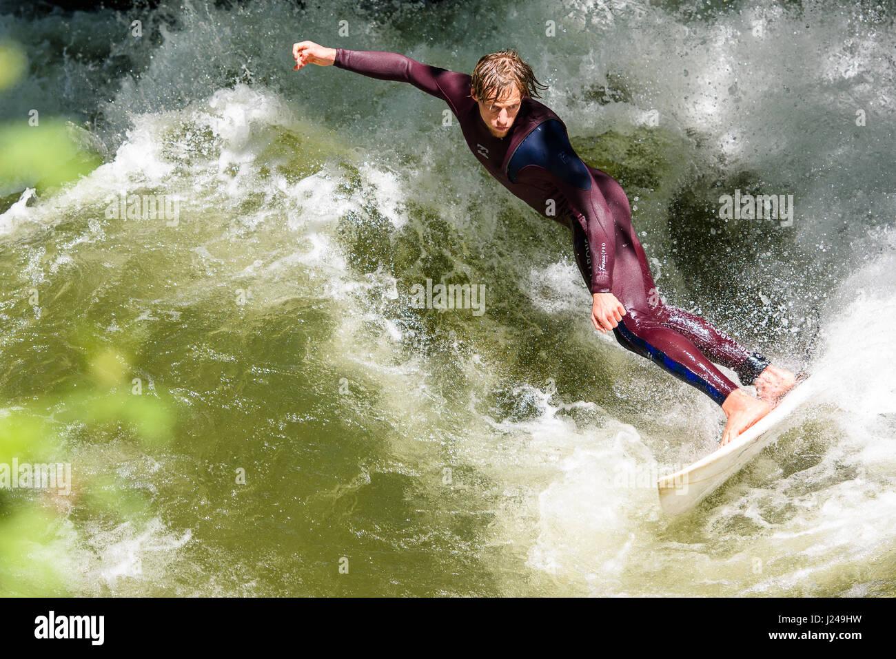 Munich, Germany. 24th Apr, 2017. A man surfs in the English Garden in Munich, Germany, 24 April 2017. Photo: Florian - Stock-Bilder