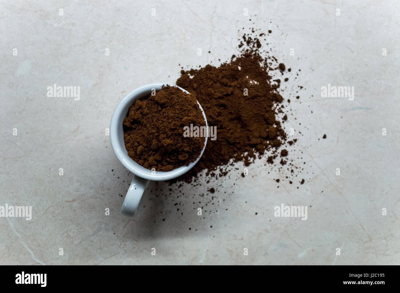 small espresso cup with ground coffee spilling J2C195 Motion Coffee Table Spilling Coffee Stock Photo Image