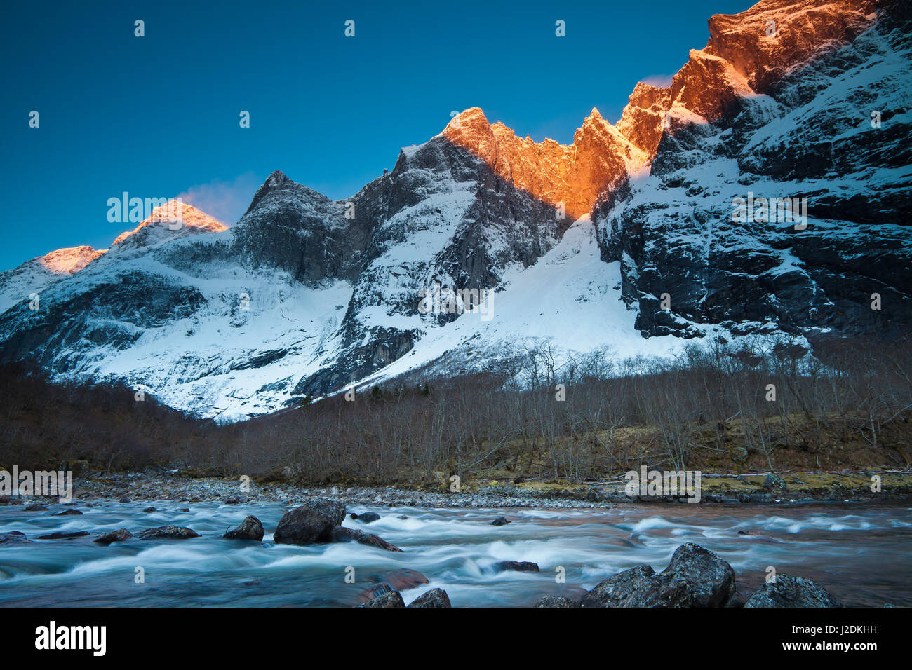 Romsdalen valley, Møre and Romsdal, Norway, April 28th, 2017. First light on the peaks Trolltindane and the - Stock-Bilder
