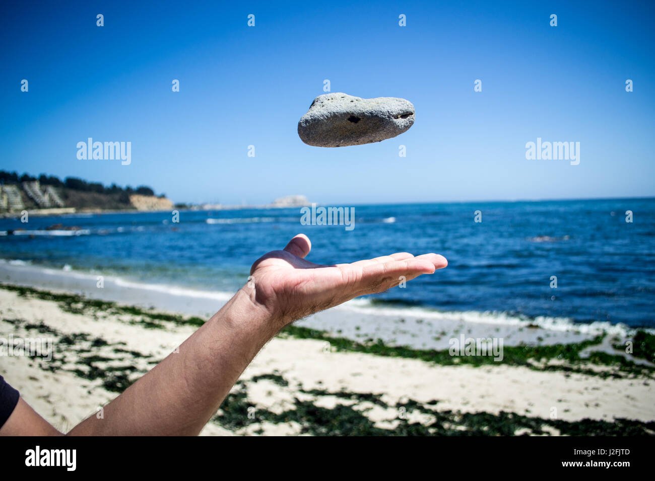 Hand Throwing Stone : Throwing a stone stock photos