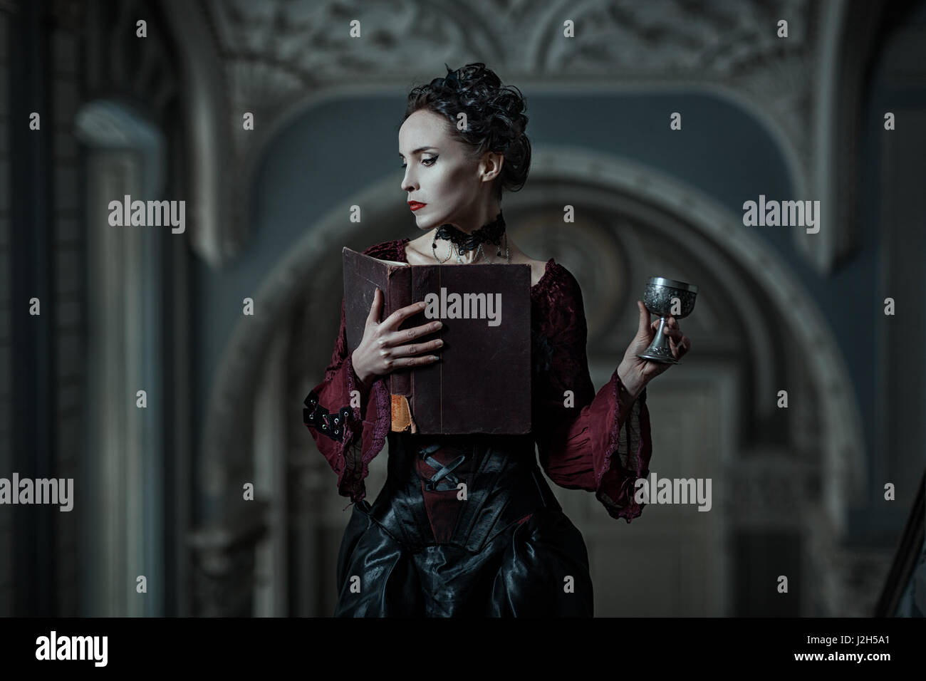 Mystic woman with book and cup in the Gothic style. - Stock Image