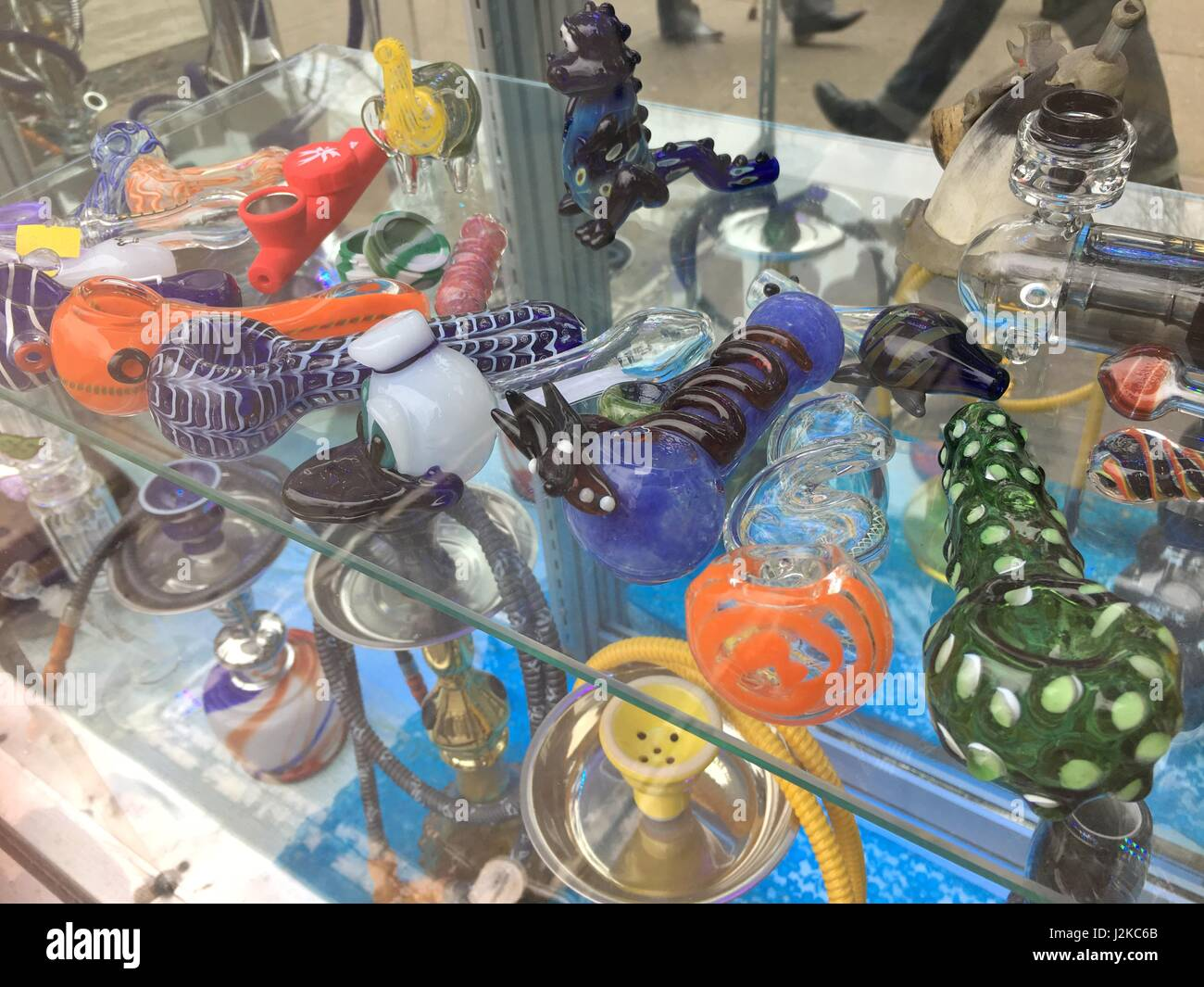 Glass bowls or bongs to smoke marijuana in multiple colors and designs. - Stock Image