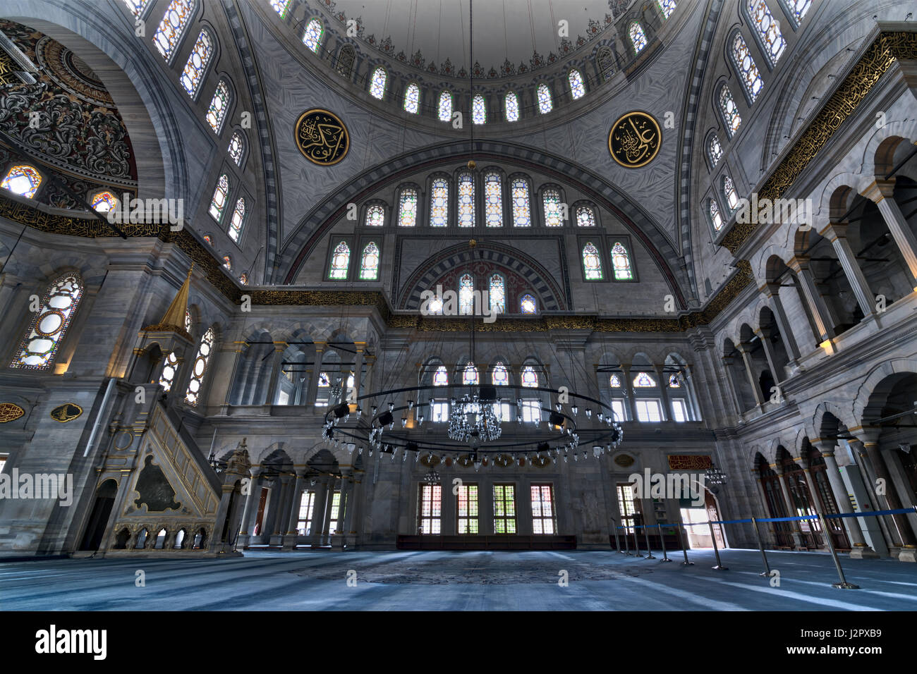 Interior of Nuruosmaniye Mosque, an Ottoman Baroque style mosque completed in 1755, with a huge dome & many - Stock Image