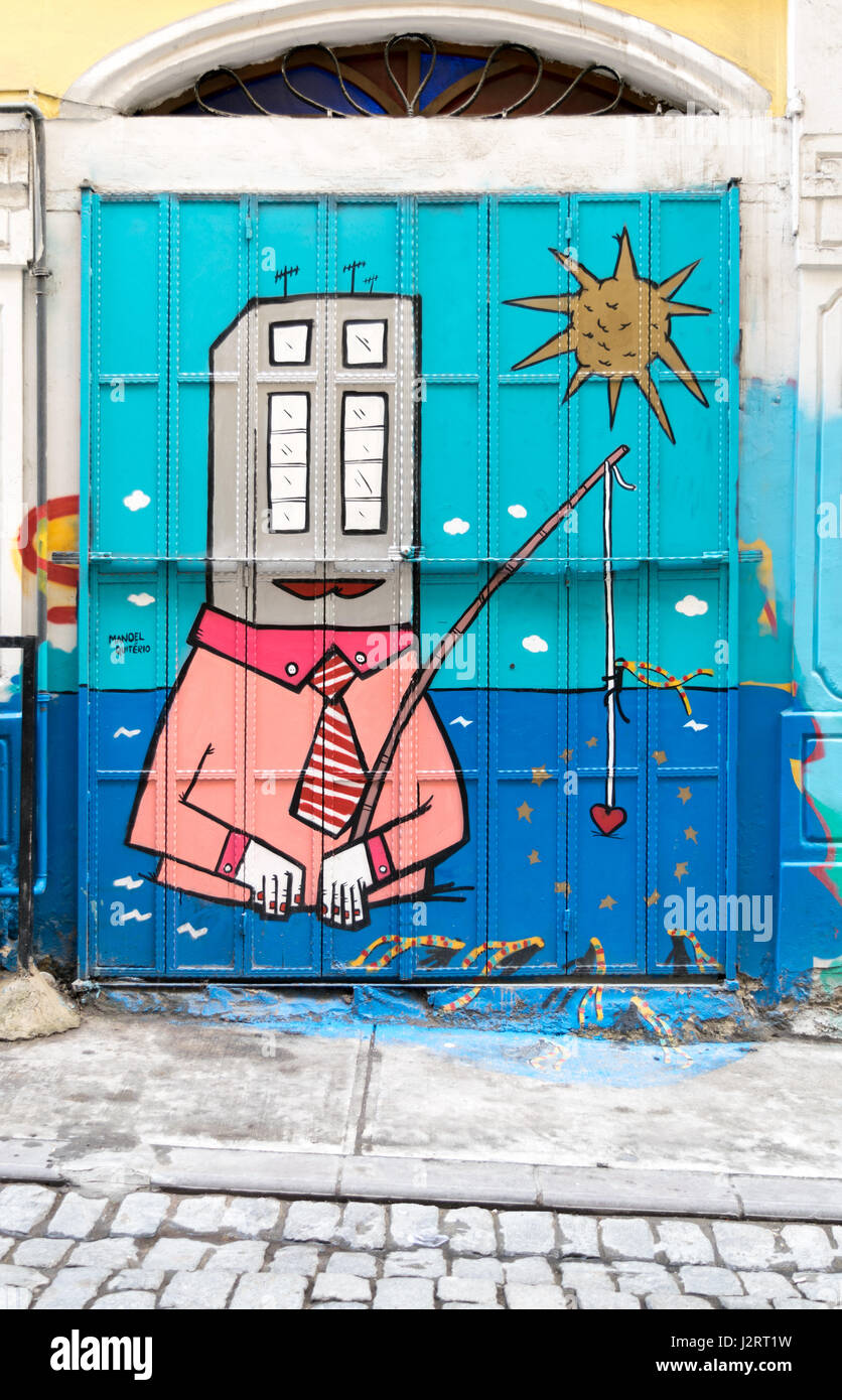 Closed shop exterior with roller door covered with colorful graffiti near Istiklal Street, Istanbul, Turkey - Stock Image