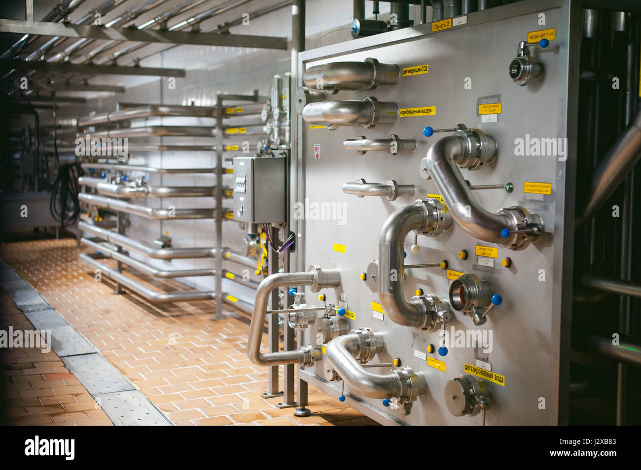 Silver pipes metal plumbing stock photos silver pipes for Production builder