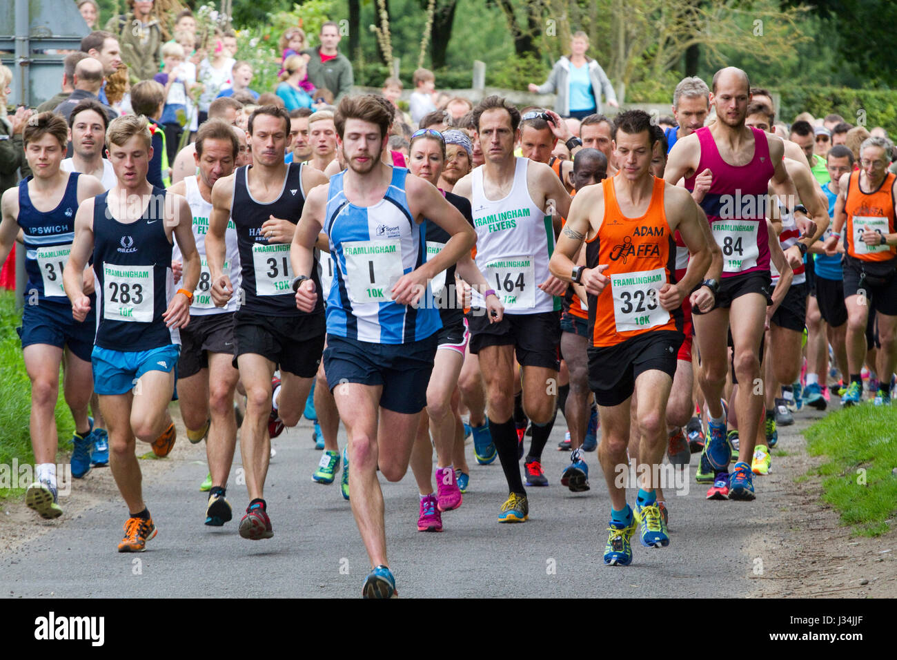 Runners at the start of a road race - Stock Image