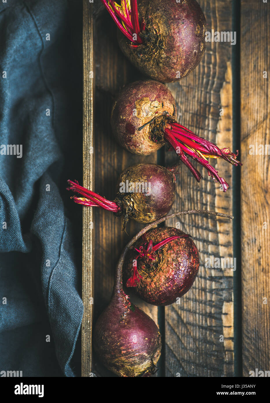 Raw organic purple beetroots in wooden box - Stock Image