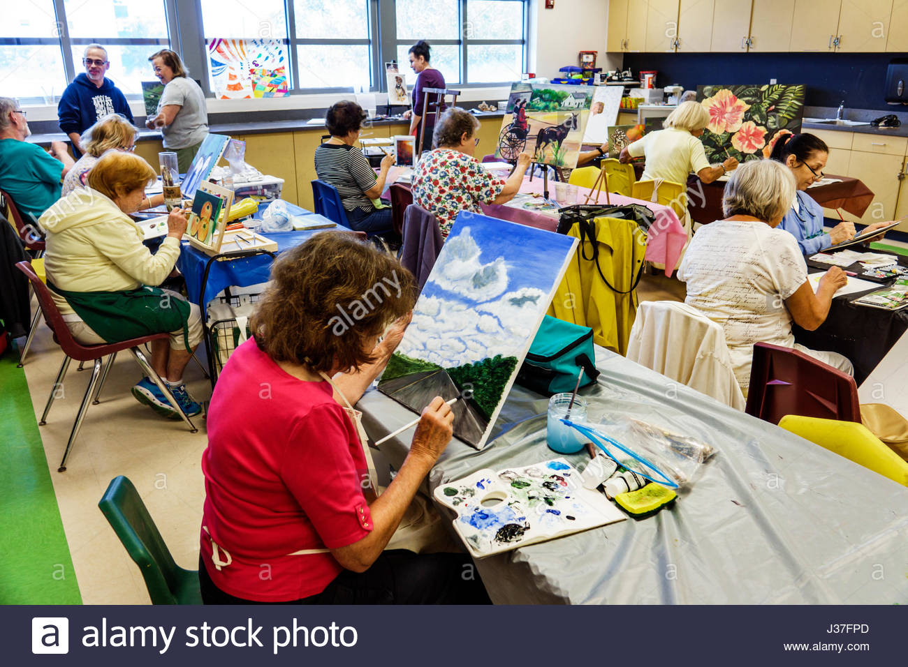 Miami Beach Florida North Shore Community Center senior education older adults seniors art class canvas painting - Stock Image