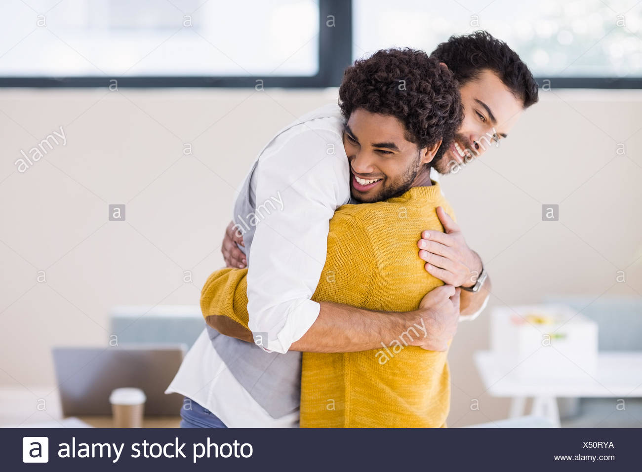 homosexual couple hugging each other stock photos