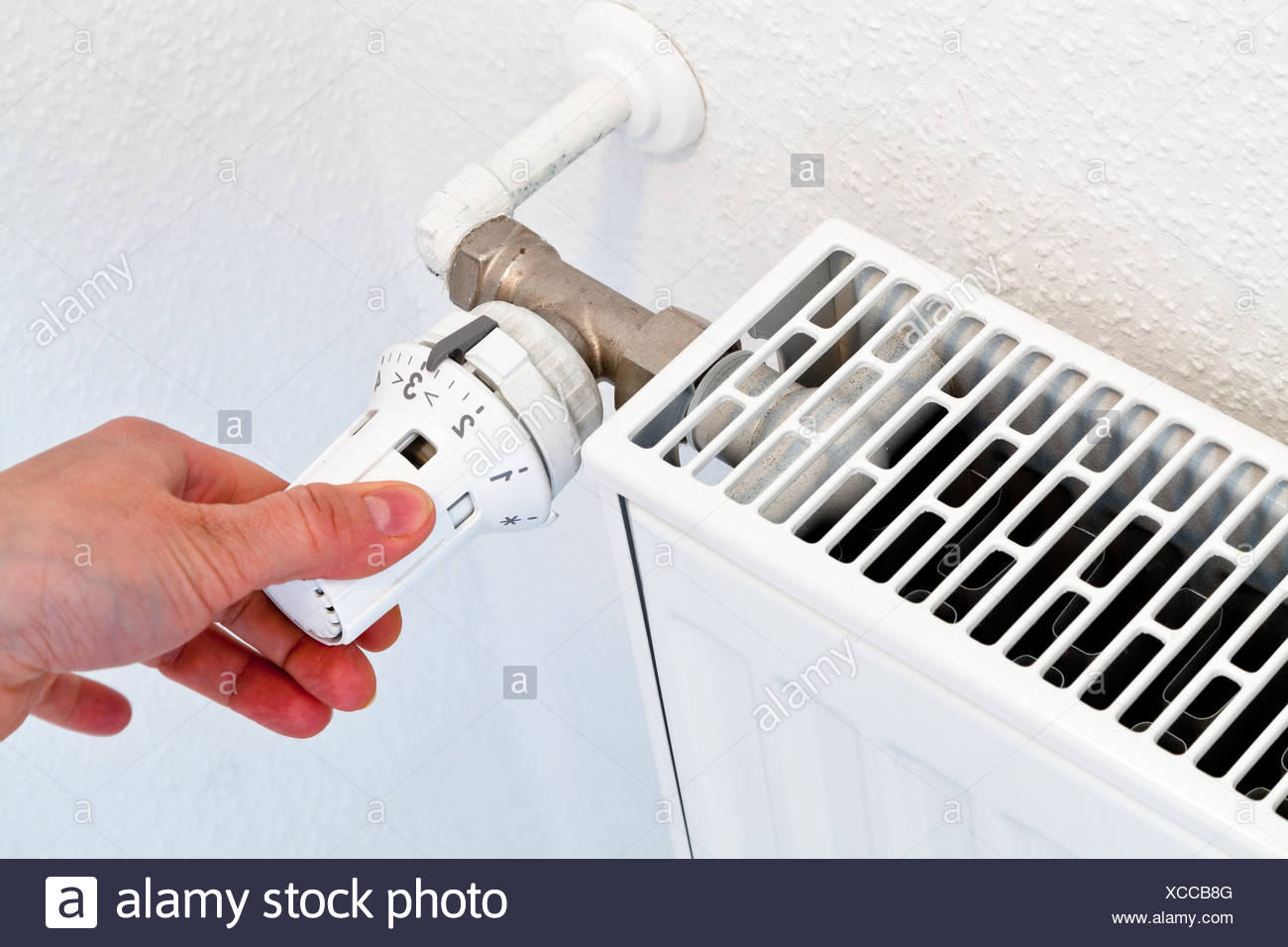 Warming hand heater radiator stock photos warming hand for Heat setting for home