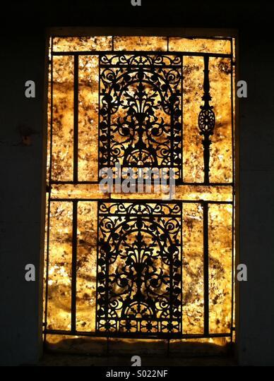 Iron window grill stock photos iron window grill stock for Victorian era windows