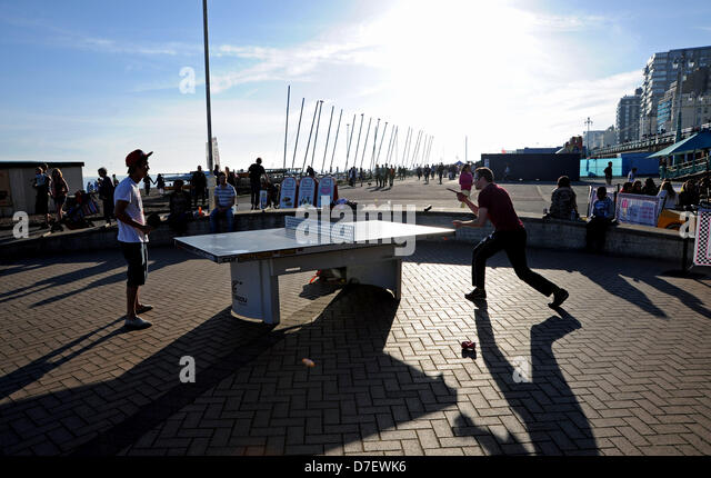Brighton UK 6th May 2013 - Playing table tennis as the sun goes down on Brighton seafront after a long hot day on - Stock Image