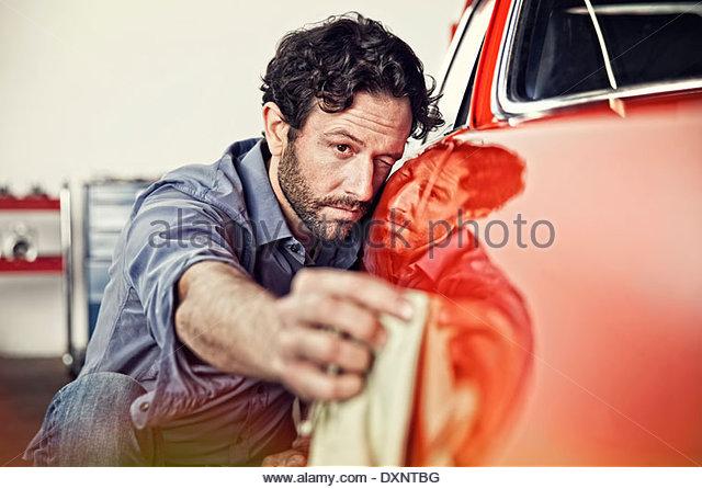 Man polishing his vintage car - Stock Image