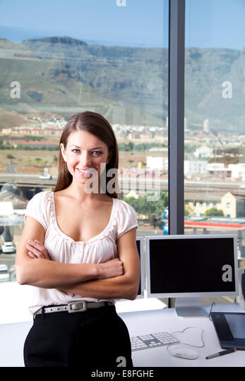 Cape Town, South Africa, Portrait of businesswoman in the office - Stock Image