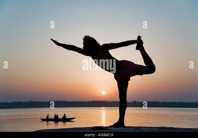 World famous yogi teacher Dr Rakesh Yogi at sunrise over the Ganges River India - Stock Image