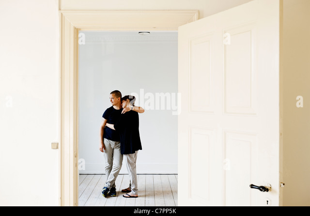 Couple hugging in new home - Stock Image