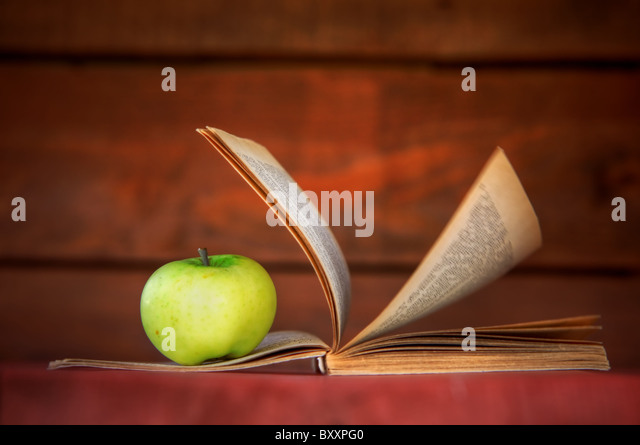 Apple and book. Education, back to school concepts. - Stock Image