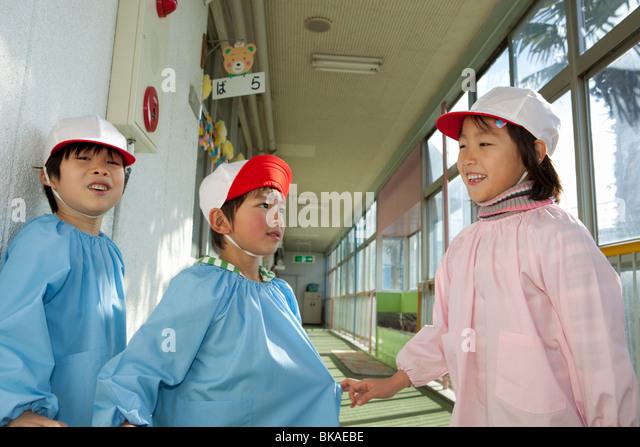 Kindergarten Children Playing at Hallway - Stock Image