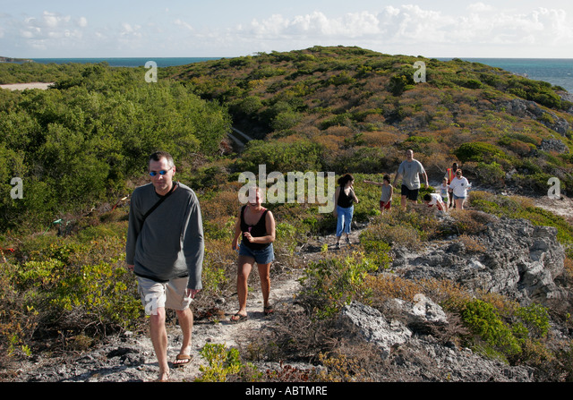 Grand Turk Hawknest Plantation Gun Hill dune buggy excursion tour trail hikers - Stock Image