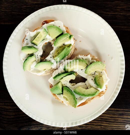 Avocado and cream cheese bagels - Stock Image