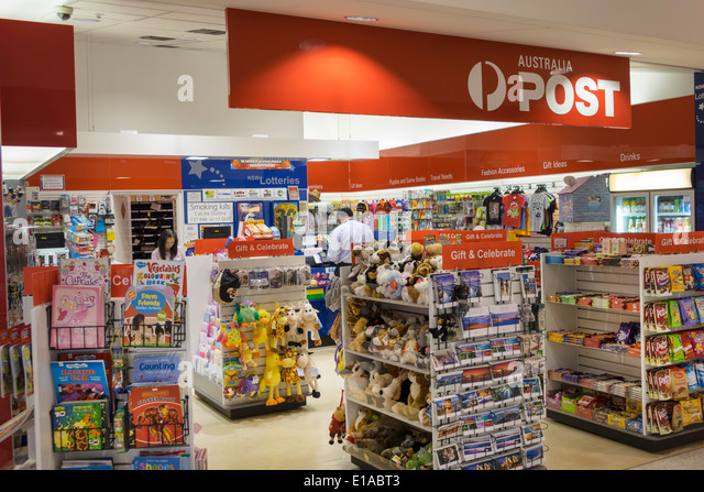 Australia NSW New South Wales Sydney Kingsford-Smith Airport SYD terminal concourse shopping Australia Post souvenirs - Stock Image