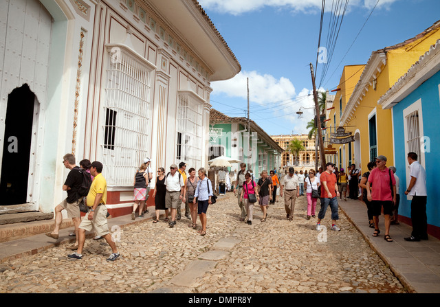 Crowds of tourists in the street, Trinidad, Cuba, Caribbean - Stock Image