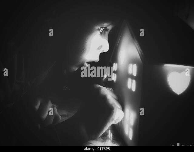 A low light portrait of a child. - Stock Image