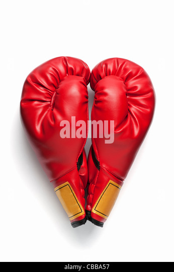 A pair of red boxing gloves in a heart shape - Stock Image