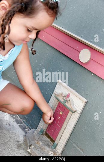 Michigan ann arbor main street fairy door black girl stock
