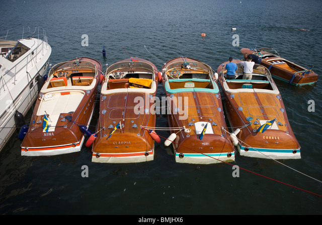 View of row of boats with two men, elevated view - Stock Image