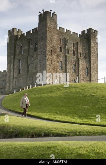 UK, England, Bamburgh, Bamburgh Castle 1050 Norman style, guide, - Stock Image