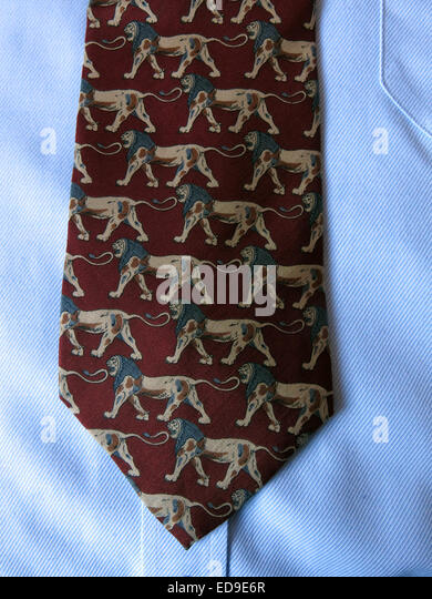 Interesting vintage maroon brown lion tie, male neckware in silk - Stock Image