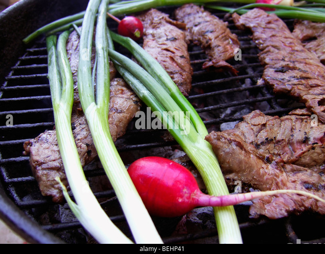 Carne Asada cooking on BBQ - Stock-Bilder