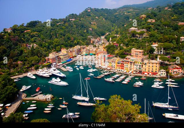 Boats moored in the tiny harbor of Portofino, Liguria Italy - Stock Image